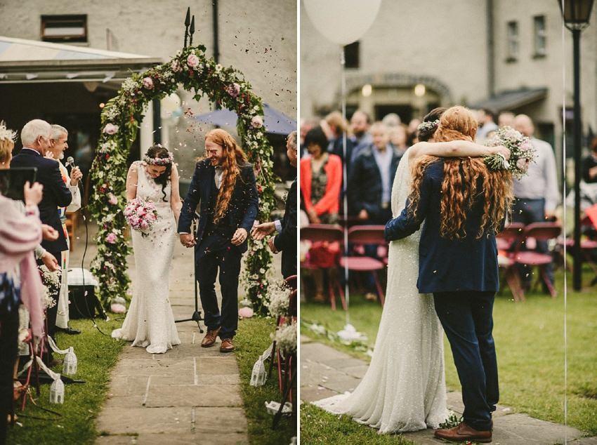 long hair groom and alternatie looking bride