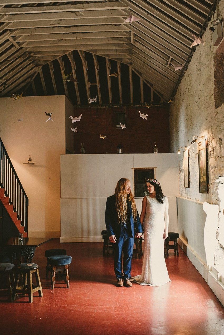 couples in old alternative wedding barn