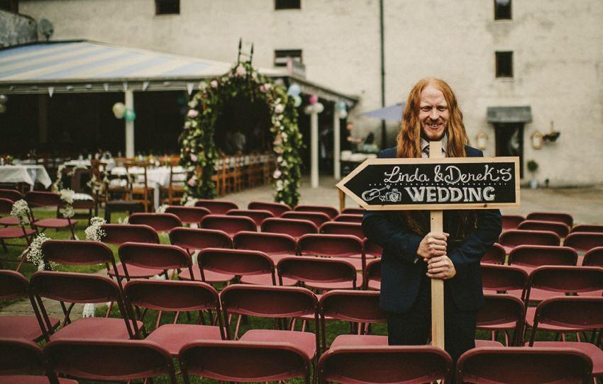 groom in alternative suite at wedding