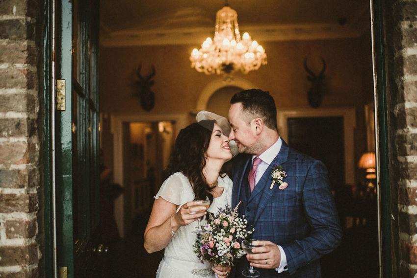 kissing at horetown house wedding