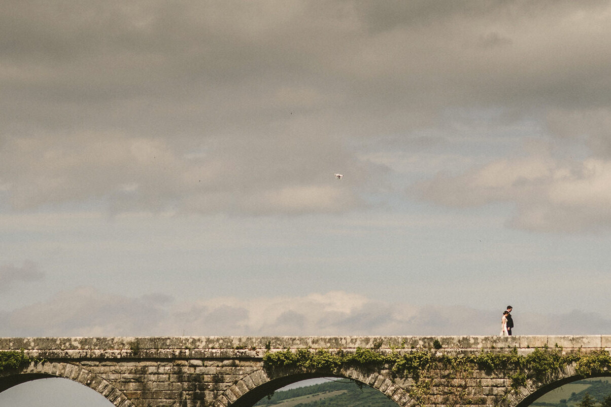 couples on bridge, natural wedding photos,wedding photography ireland