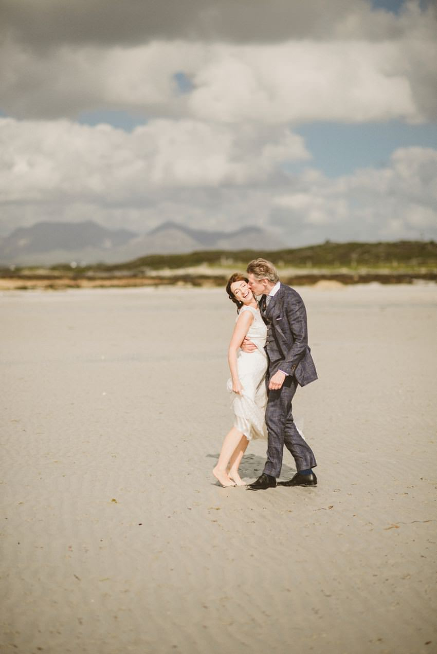 married couples on connemara beach