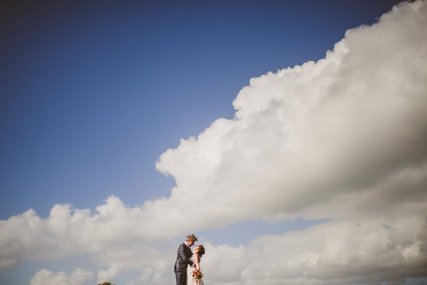 couples with sky in background