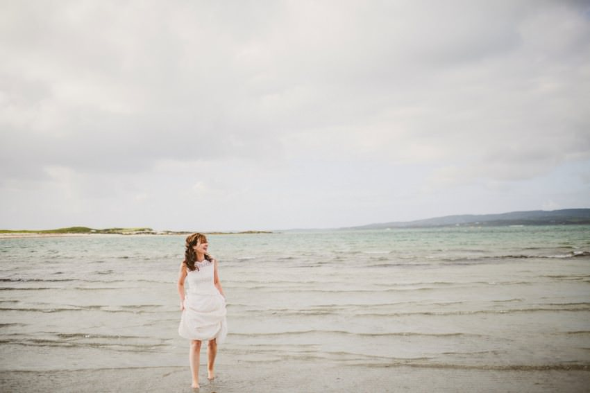 Connemara Wedding Photography bride walking on beach