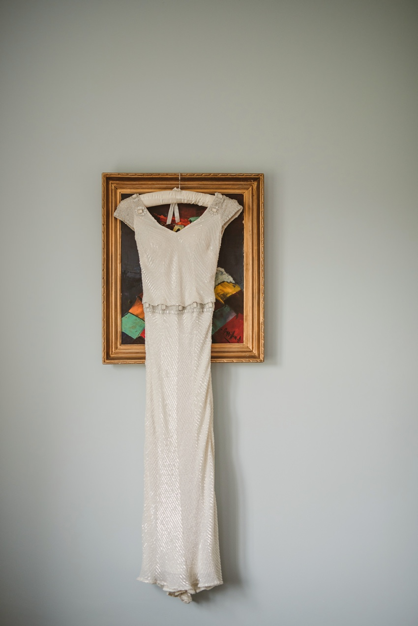 vintage wedding dress hanging