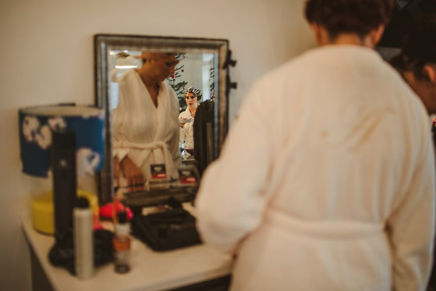 bride in the mirror when getting ready