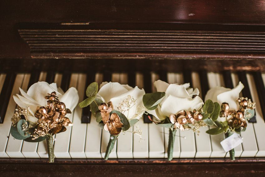 wedding flowers on piano