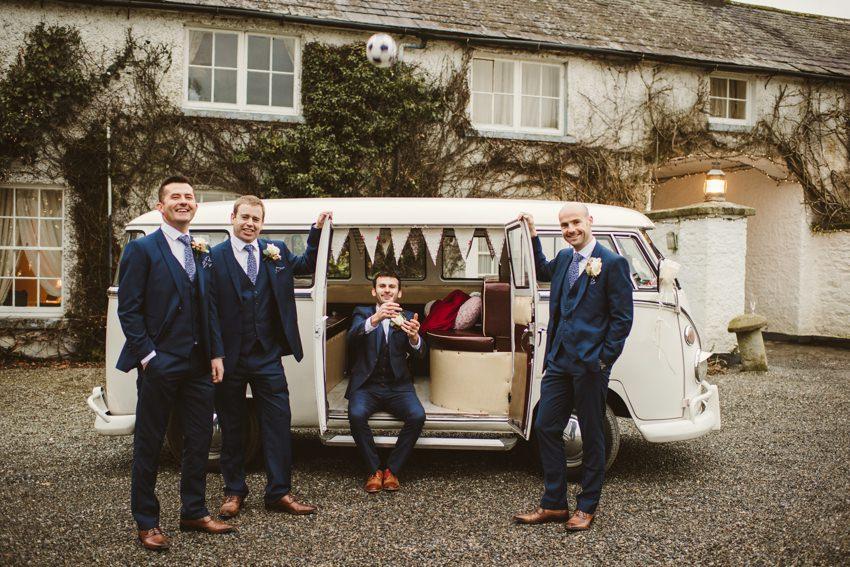 groom and groomsman in vintage camper van