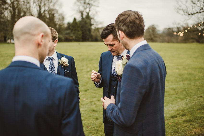 groom checking rings
