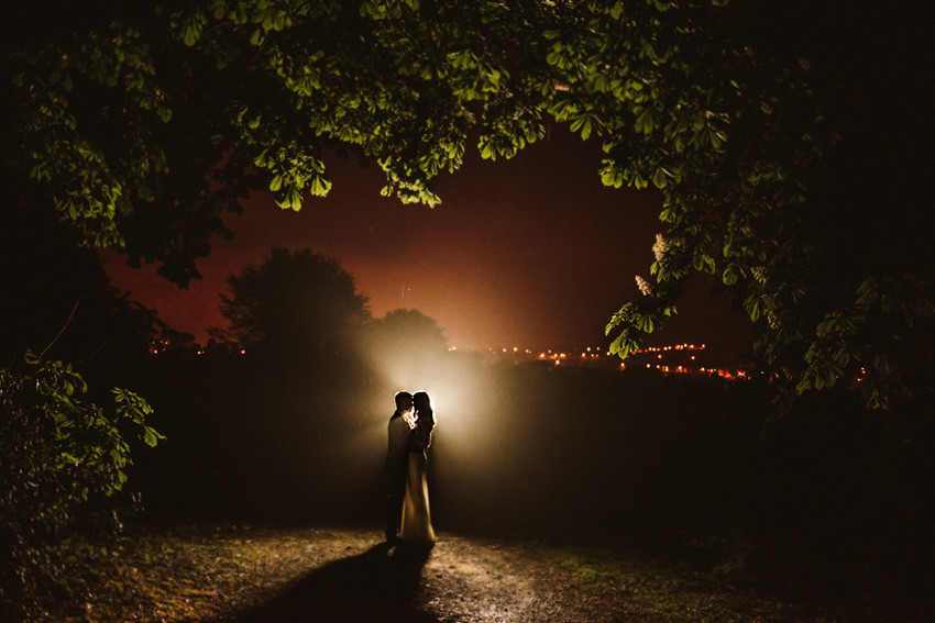 Tinakilly House Wedding at night time with light of rathnew Town in background