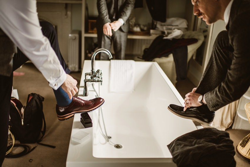 groom cleaning his wedding shoes