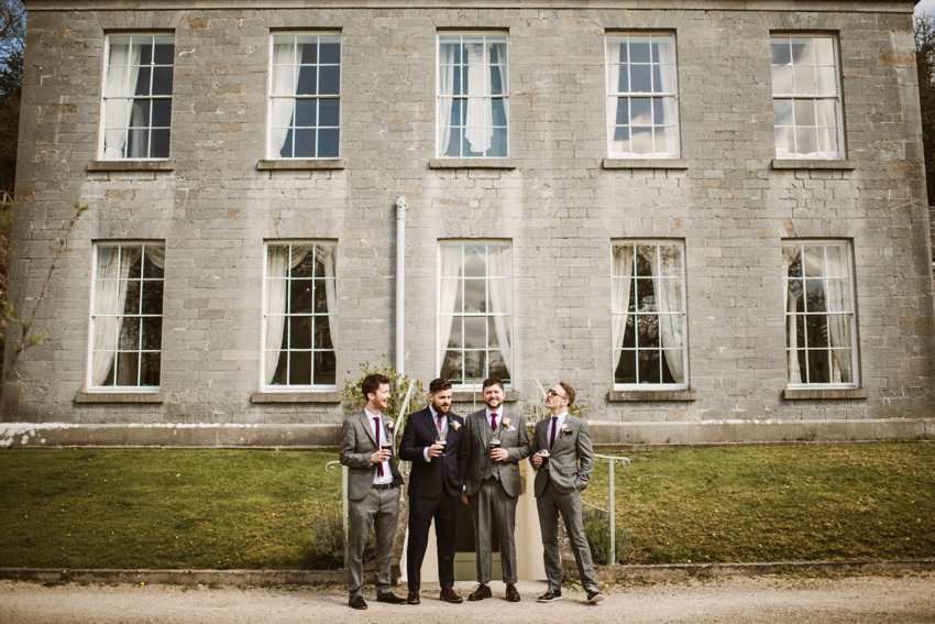 wedding gang at front of The Millhouse building