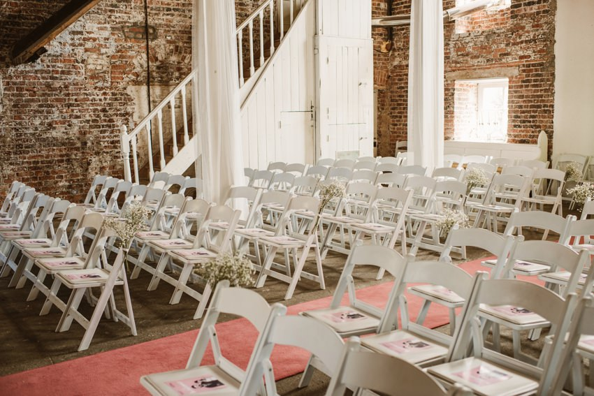 ceremony room inside in the Millhouse with white chairs
