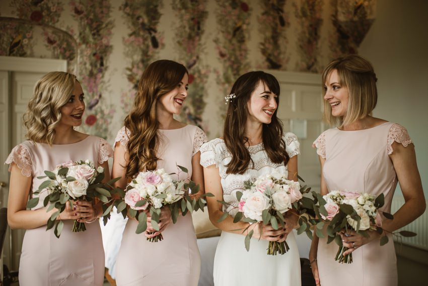 bride and bridesmaids with big wedding bouquet