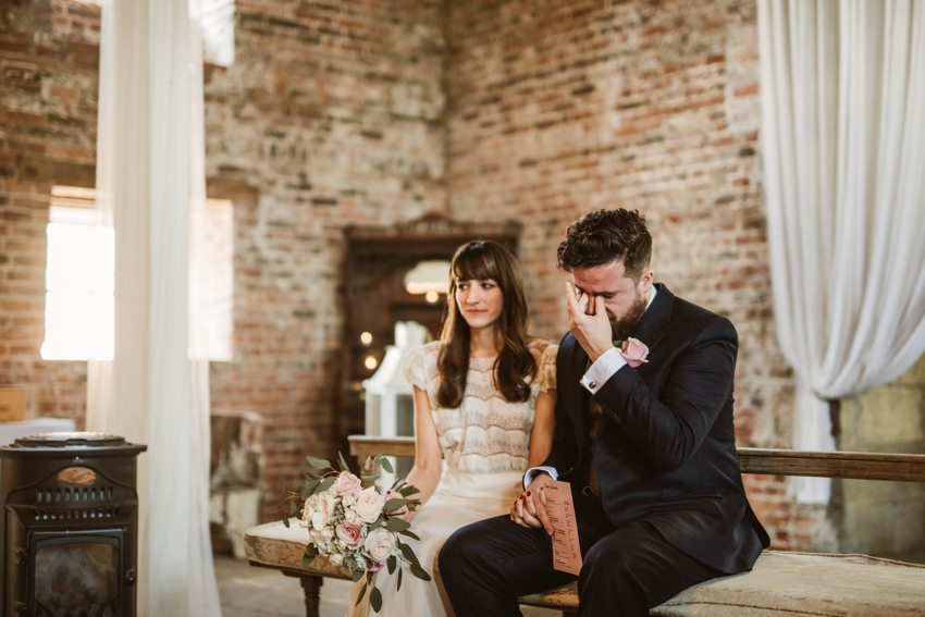 emotion during ceremony, groom crying when his brother playing on guitar in Millhouse