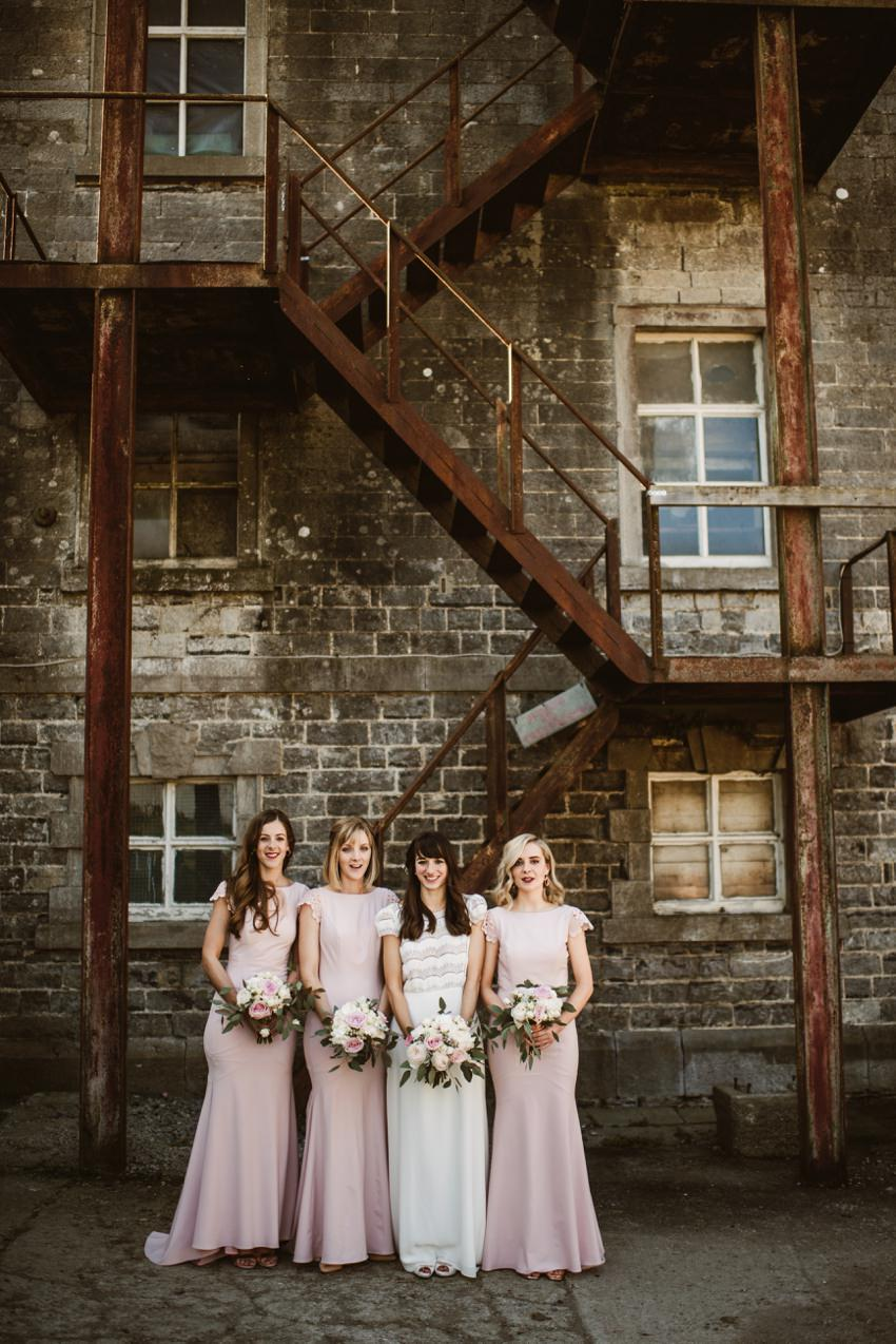 bridal party at front of Industrial stairs in The Millhouse co.Meath Ireland
