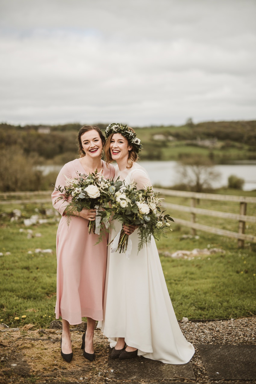 bride and bridesmaid in light pink colour dress