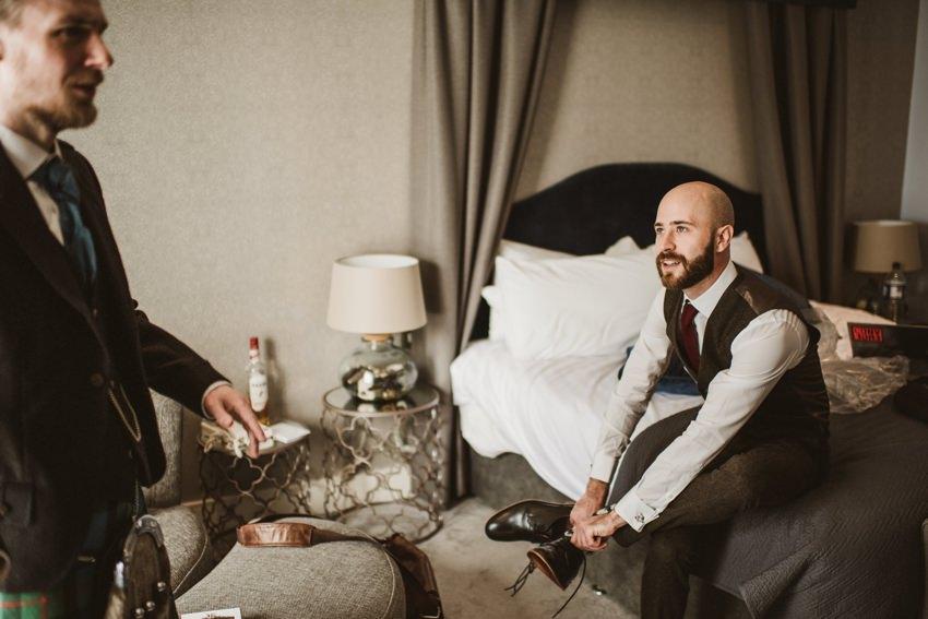 groom getting ready in hotel doolin