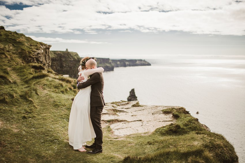 married man and woman having an intimate ceremony at cliffs in Ireland