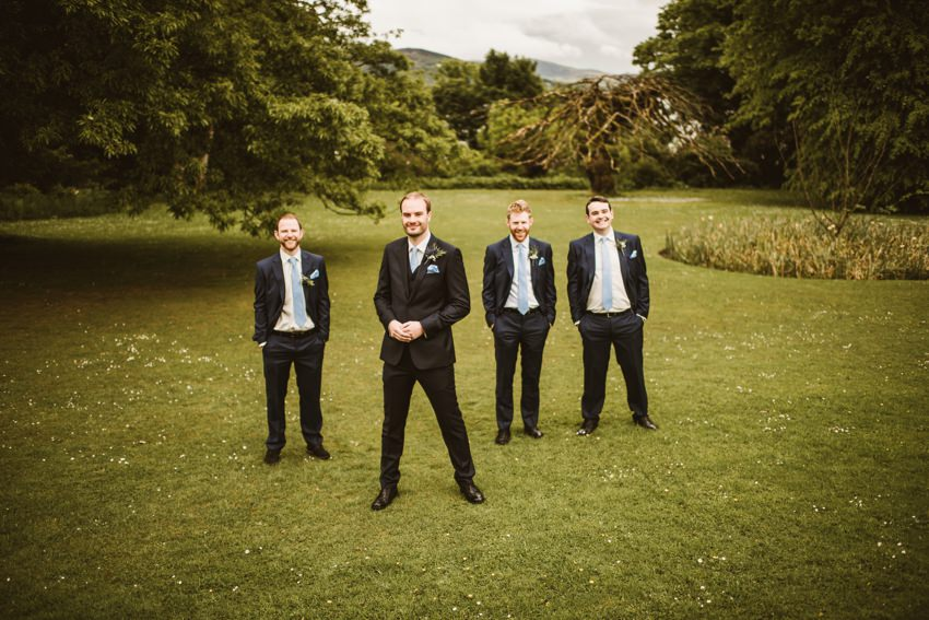 groom and groomsman at lawn in front of rathmullan house co.donegal Ireland