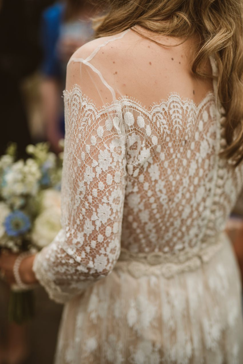 art work on bride dress made from lace