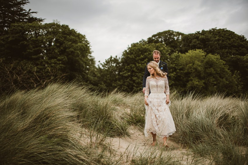 irish bride and groom at beach during photographs be taken by Darek Novak Photography
