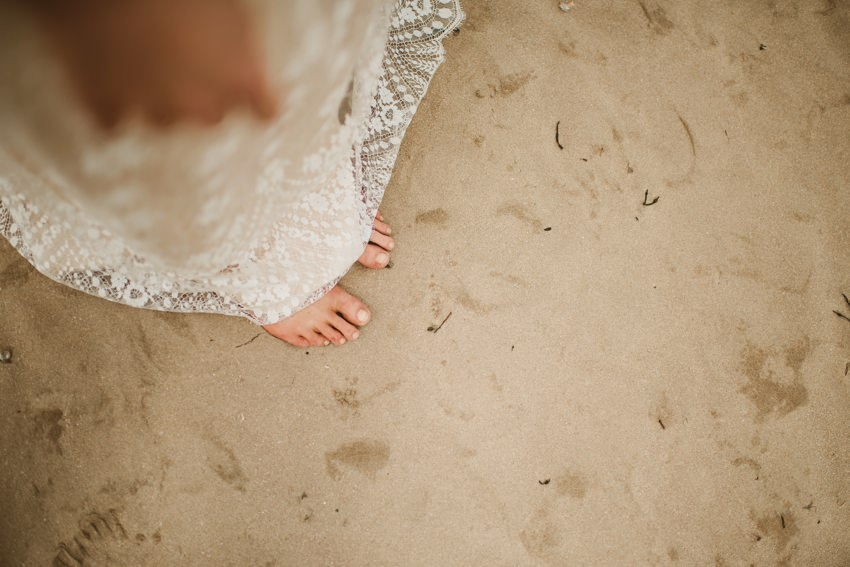barefoot walk on beach in wedding dress