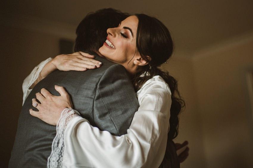 bride emotional hug from dad