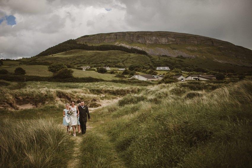 bride walk for ceremony knocknarea mountain at background