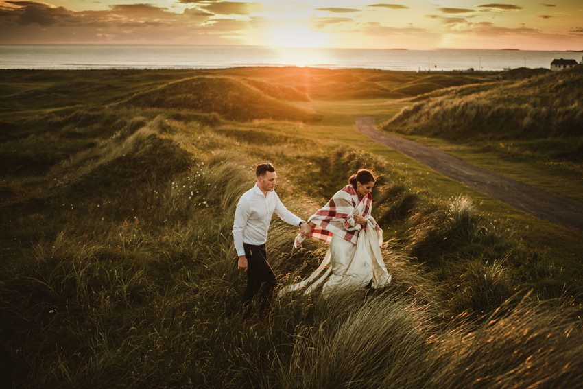best psunset photograph for wedding in ireland. bride wearing white dress in worm nice day