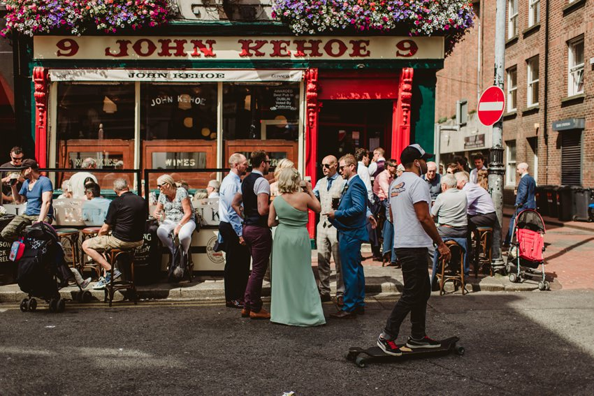crowd of wedding guests at front of John Kehoe pub in city centre
