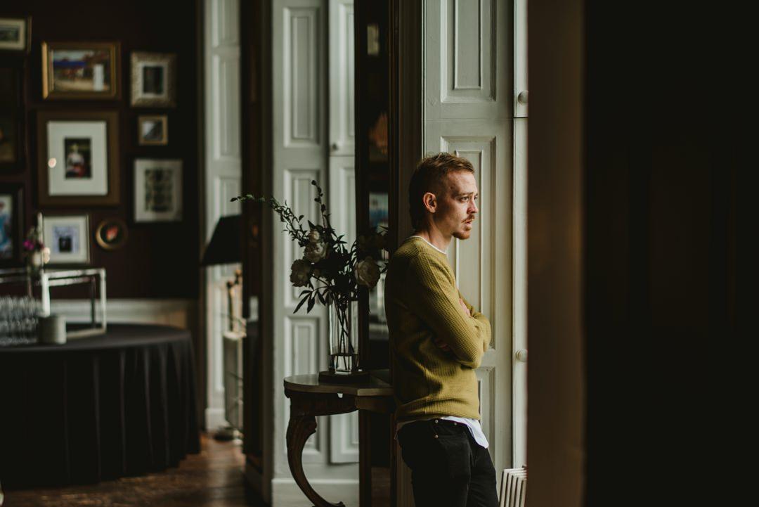 man beside big window in bellinter house