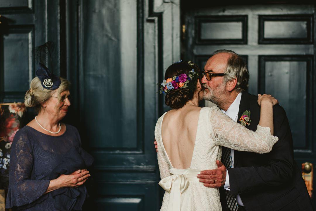 bride kissed by dad