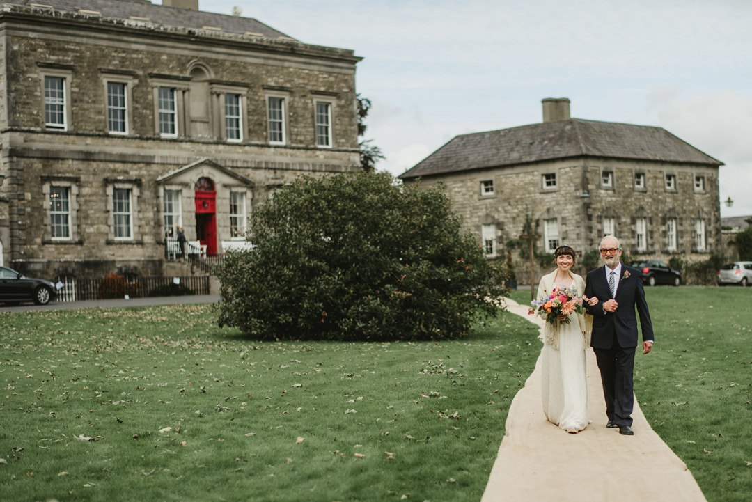 Bride walk with father for ceremony in  Bellinter House