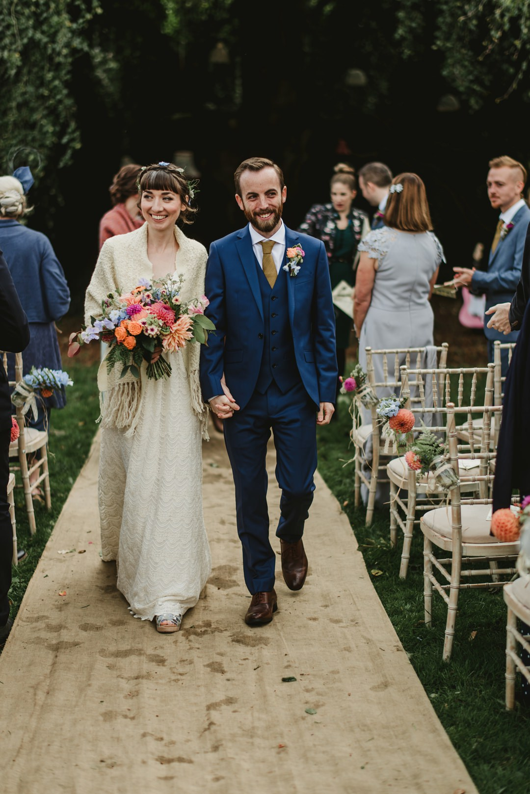 bride and groom walk on jute carpet