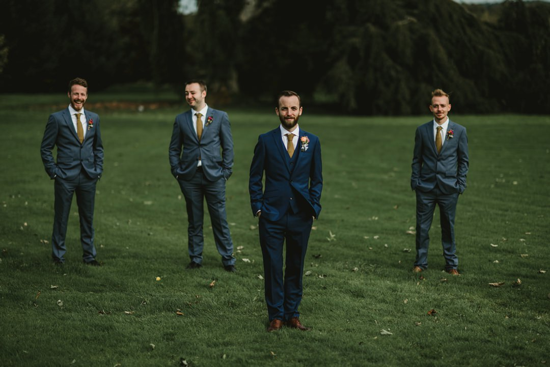 groom and groomsman at front lawn