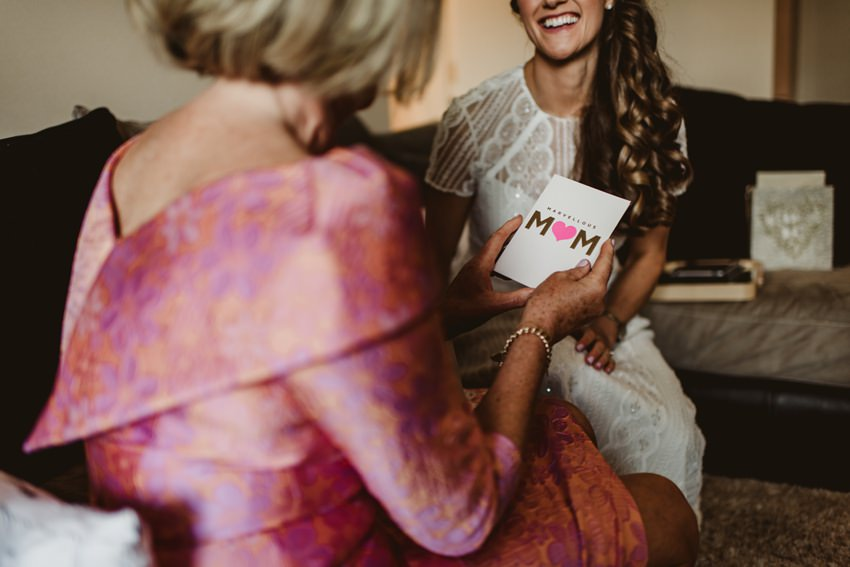 bride giving present to her mum