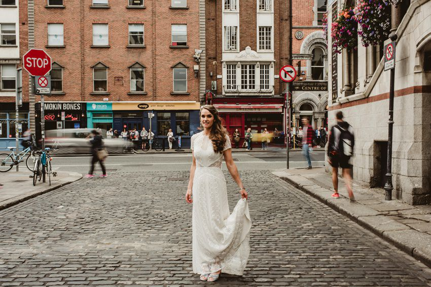 bride in white dress at front of Foggy Dew bar
