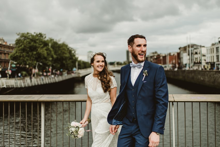 married couples walk on Ha'penny bridge.