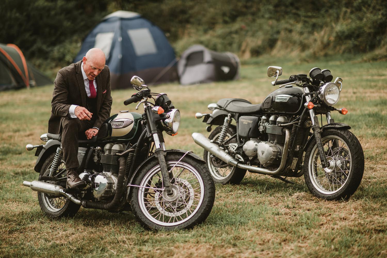 groom sitting on Triumph bike