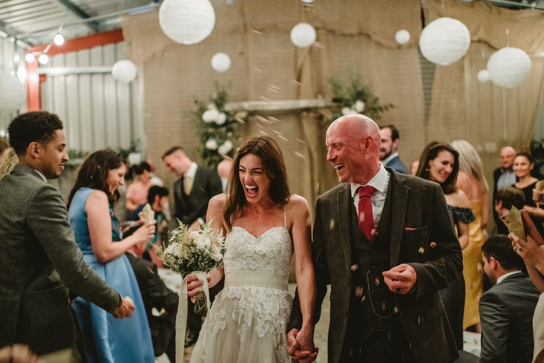 happy people leaving wedding ceremony