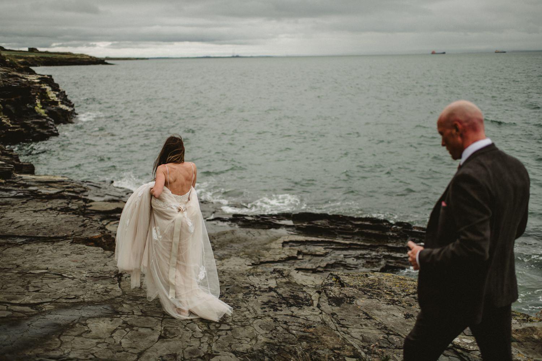 bride walking beside the sea