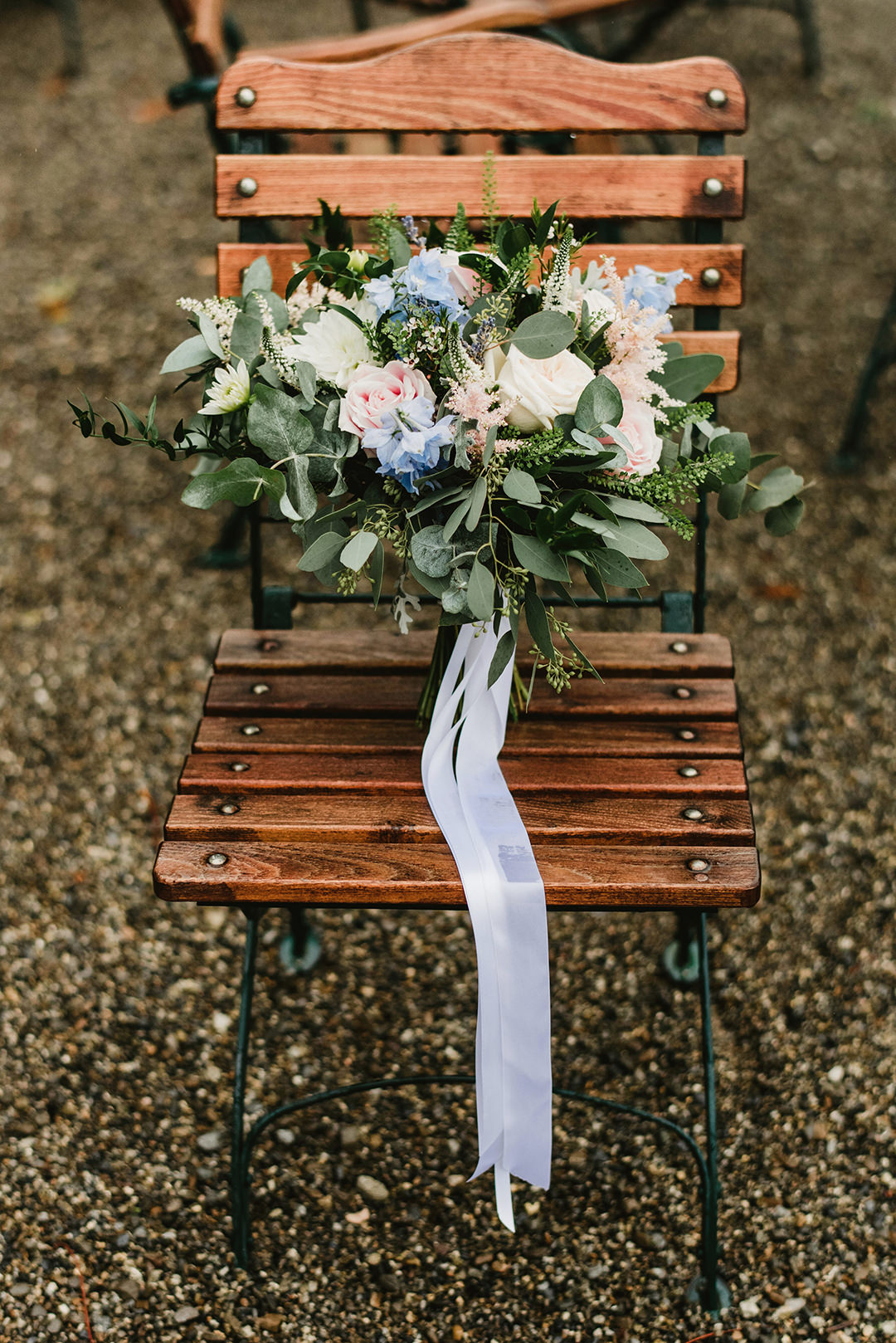 wedding flowers in festival style laying at chair