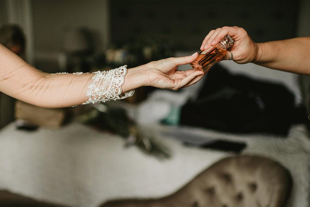 bride using a perfume