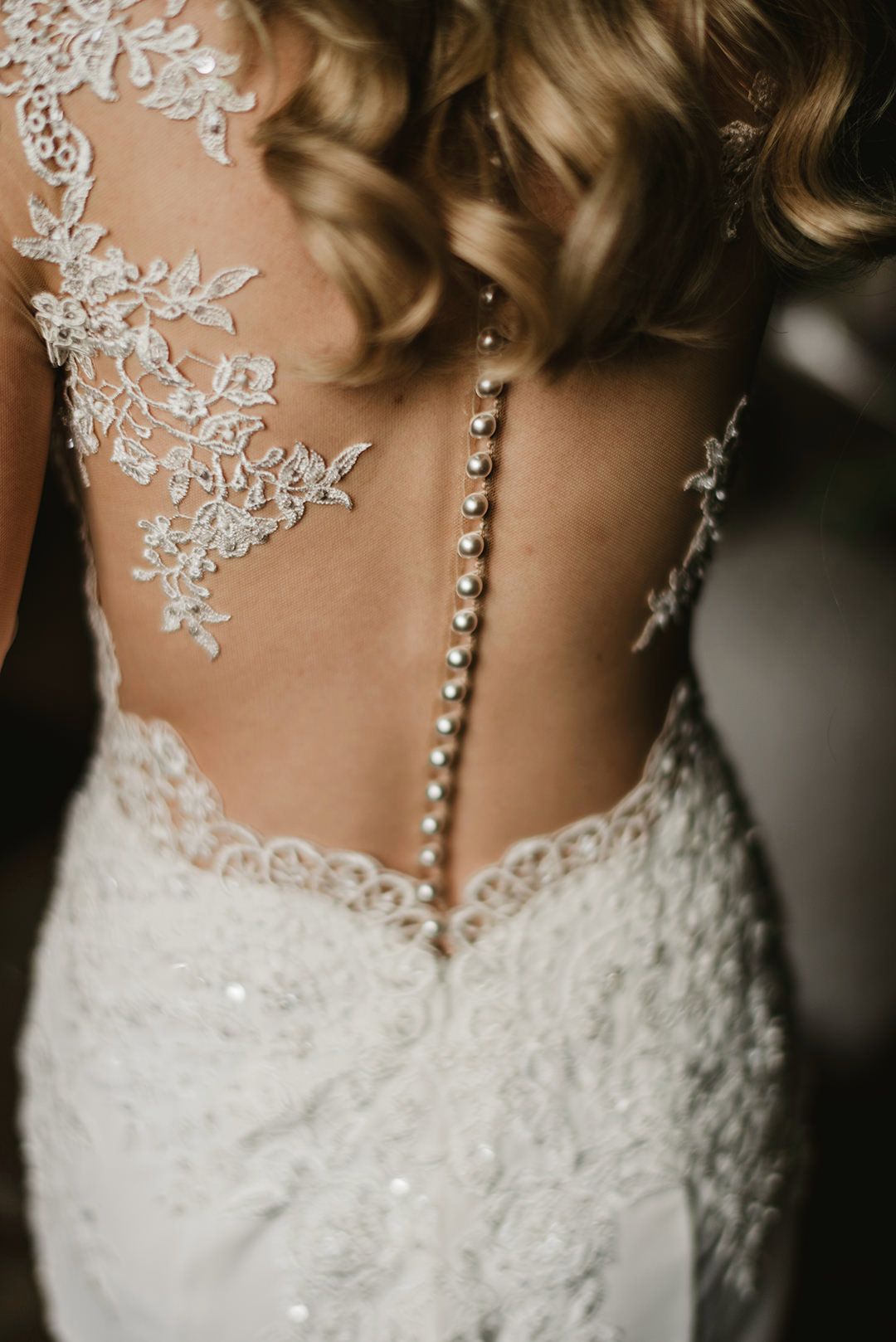 back of detailed dress on bride