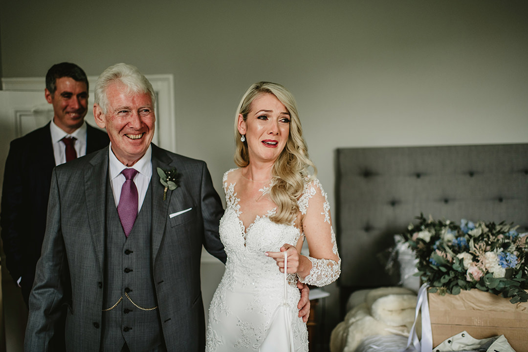 father of the bride reaction when he see his doughter in white dress. Bride crying from happines