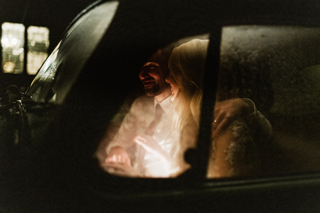 picture taken at night with bride and groom sitting inside vw beetlenight picture