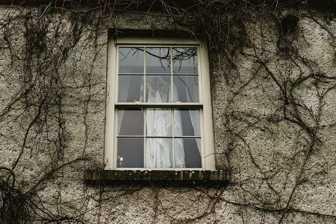 You can see white Bride dress hanging at the window on the top flor of Cloughjordan House