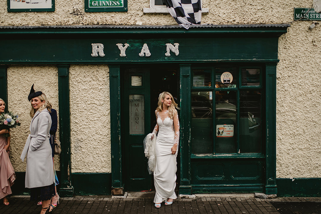 bride at the front of old irish pub.