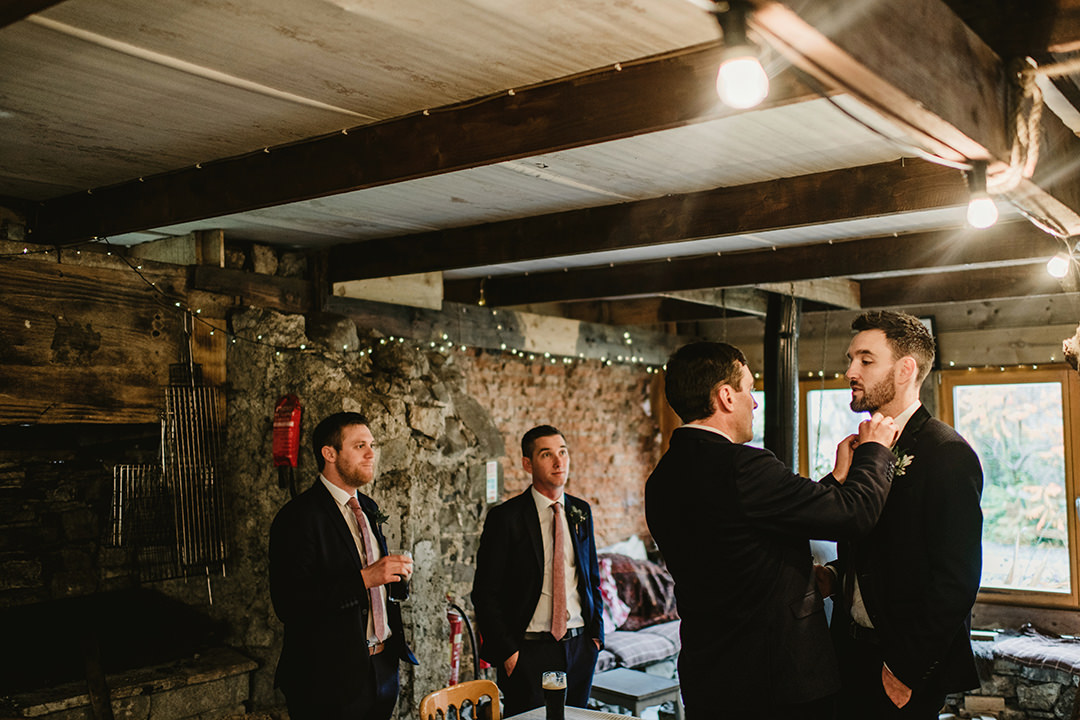 groom and groomsman waiting for ceremony in one of outbuilding in Cloughjordan House